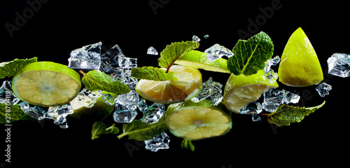 Fotografie, Obraz  Mint, lime slices and ice on the glass table, bottom view.