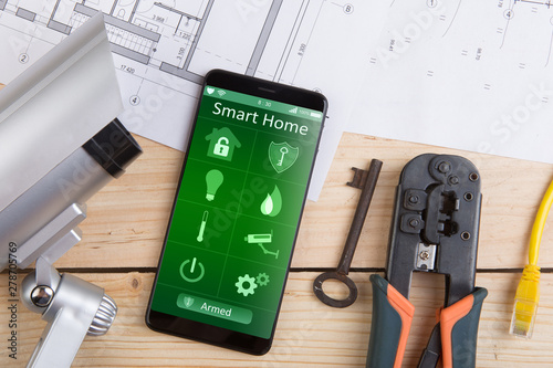 Home security concept smartphone with smart home app and