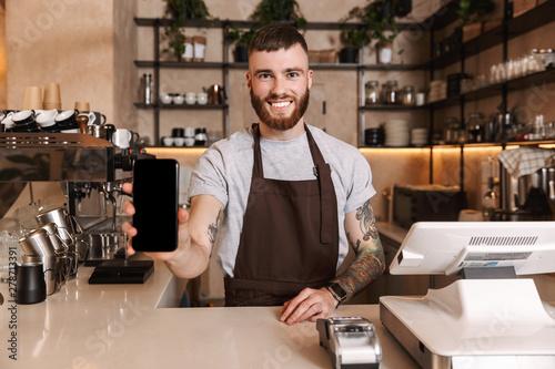 Smiling attractive man barista standing Wallpaper Mural