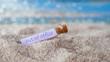 Leinwandbild Motiv Out of office- Flaschenpost im Sand-Konzept Urlaub