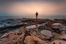 Woman Standing On Sandstone Ro...