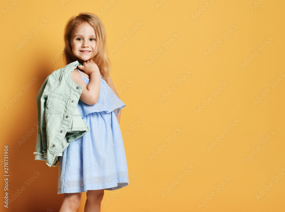 Fototapety, obrazy: Full length portrait of a cute little child girl in a stylish dress and denim.