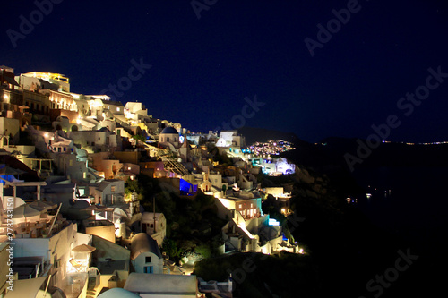 Poster Pleine lune the town of fira at night on the island of santorini