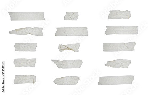 Obraz Strips of clear masking tape. Set of various adhesive tape pieces isolated on white background. Paper tape texture. Wrinkled sellotape. - fototapety do salonu