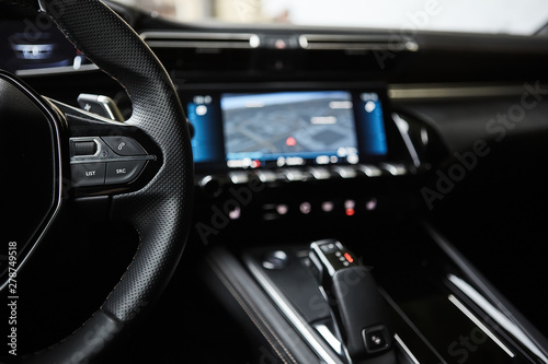 selective focus of steering wheel near gear shift handle in luxury car фототапет