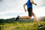 athlete runner run on summer mountain plateau in sunset