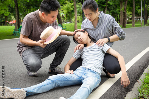 Asian child with heat stroke,high temperature, vertigo,dizziness,sick daughter o Canvas Print