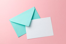 Green Envelope And Blank Letter On Pink Background. Template With Place For Text On Postcard. Mock-up