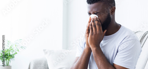 African-american man man has runny nose at home Fototapet