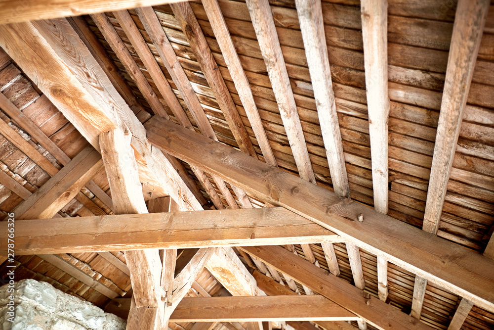 Fototapeta Wooden roof frame in an old house in the countryside.
