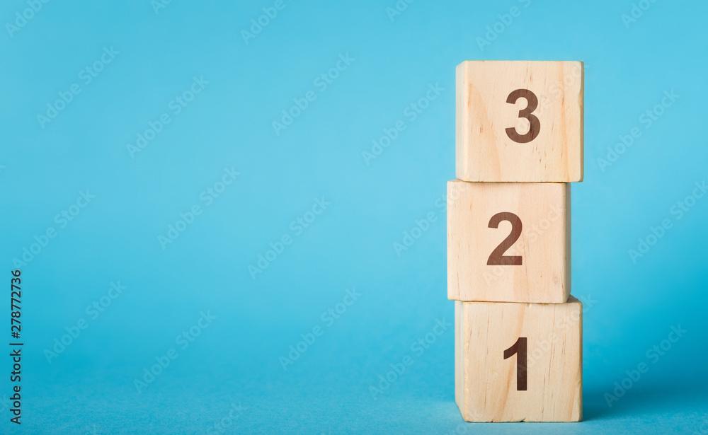 Fototapeta Wooden alphabet number blocks 123 on blue background