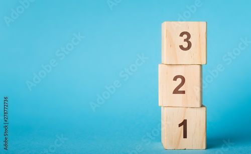 Wooden alphabet number blocks 123 on blue background Canvas Print