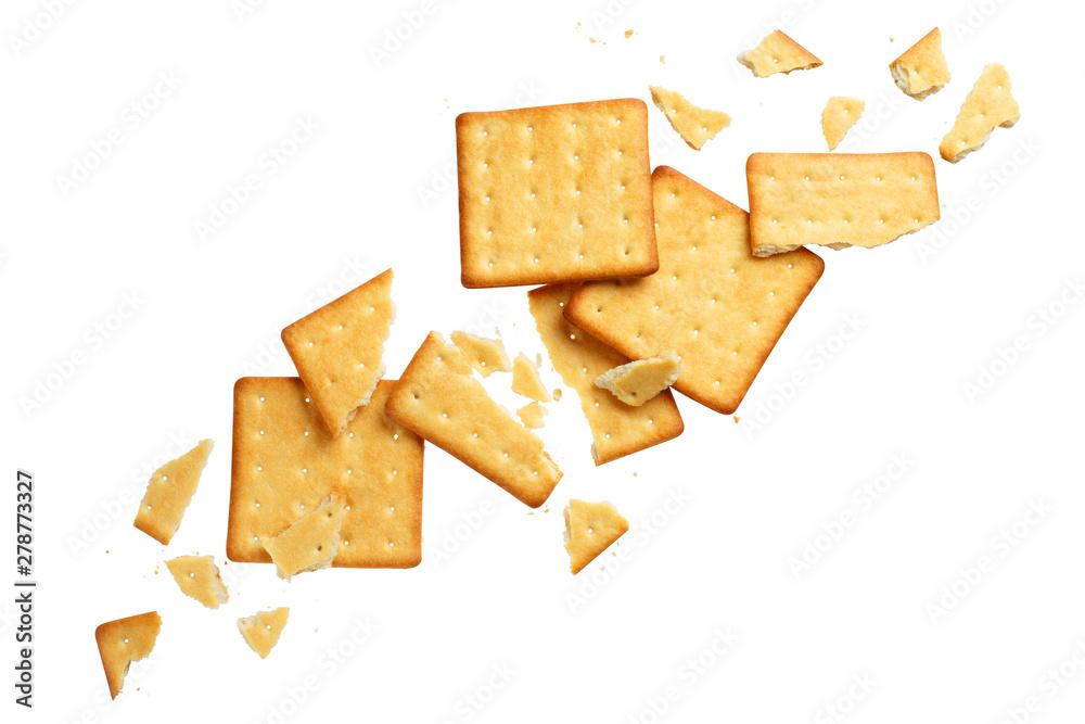 Fototapeta Crushed dry crackers, isolated on white background