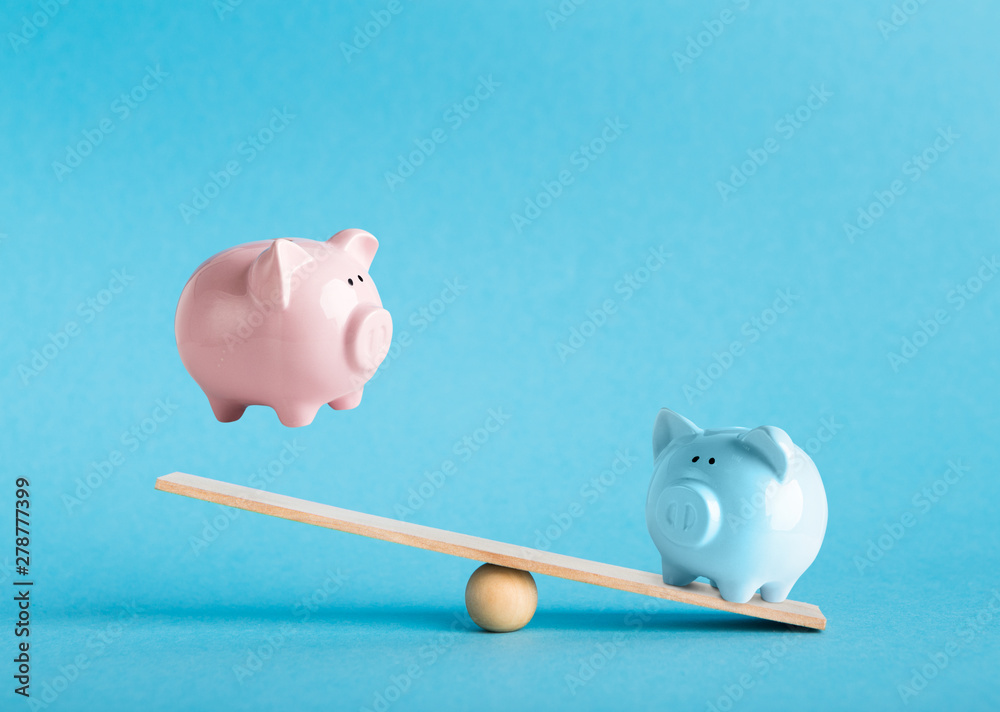 Fototapeta Comparison of two variants of investing money with piggy banks