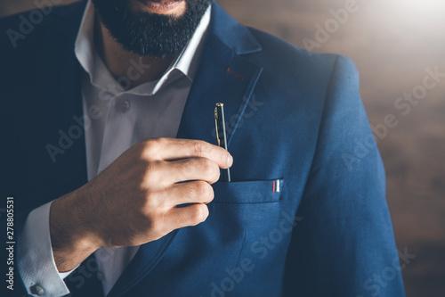 man hand pen in pocket Fototapeta