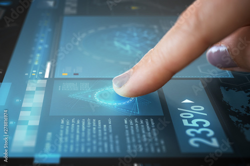 Valokuva  technology and people concept - finger touching interactive panel with virtual p