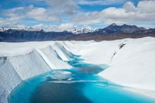 Blue Lake On The Matanuska Glacier. Supraglacial Lake On Top Of The White Ice. Deep Blue Color.