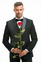Valentines Day And Anniversary. Dating Services. How To Be Romantic. Romantic Gentleman. Man Mature Confident Macho With Romantic Gift. Handsome Guy Rose Flower Romantic Date. Perfectionist Concept
