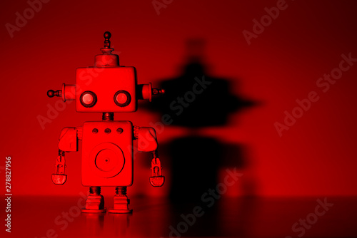 Photo  Robot on a red background.