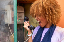 Woman Yelling Into Old Fashioned Telephone Receiver