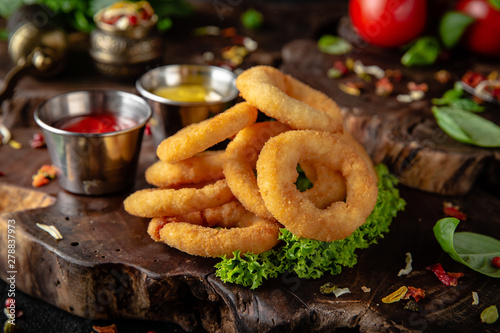 Fototapeta Delicious crunchy snack: chicken nuggets, french fries and breaded onion rings obraz