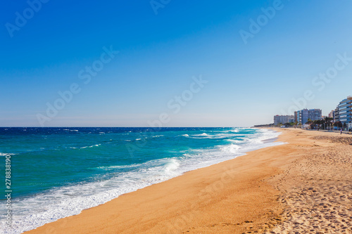 Foto auf AluDibond Barcelona Sea landscape in Blanes, Catalonia, Spain near of Barcelona. Scenic town with nice sand beach and clear blue water in beautiful bay. Famous tourist resort destination in Costa Brava