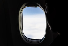 Aerial View Of White Clouds From Airplane Window With Silhouette Man Face Look Outside