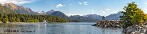 Panoramic view of the harbor with a fishing boat sailing in the distance in Sitka, Alaska Fototapet