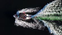Wakesurfing Behind A Boat High...