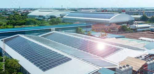 Obraz  Solar panels or Solar cells on factory rooftop or terrace with sun light, Industry. - fototapety do salonu
