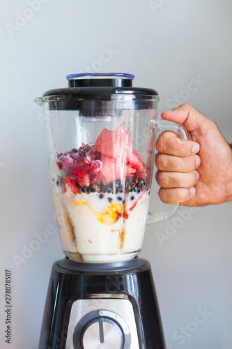 Obraz na plátně A blender filled with fresh whole fruits for making a smoothie or juice