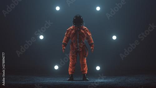 Tela Astronaut in an Orange Advanced Crew Escape Space Suit with Black Visor Standing