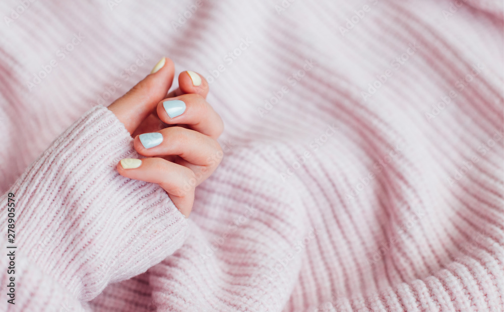 Fototapety, obrazy: Fresh blue and yellow manicure with sweater on background.