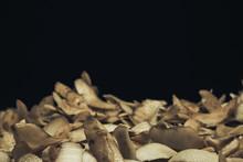 Potato Skins On A Black Background. Close Up.