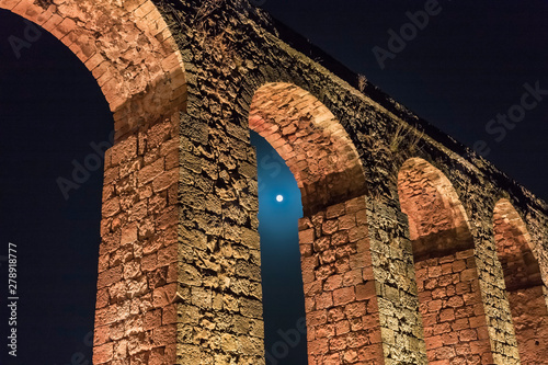 Night  view of the remains of an ancient Roman aqueduct located between Acre and Wallpaper Mural