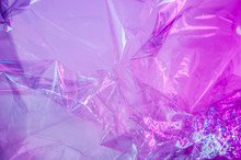 Holographic Background In The Style Of The 80-90s. Real Texture Of Cellophane Film In Bright Acid Colors.