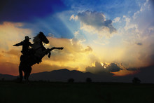 Silhouette Cowboy On His Horse Riding On Two Legs