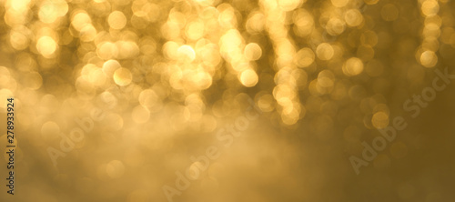Fotografiet  Golden bokeh background close up