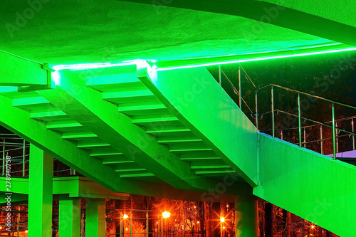 the architecture of the building stairs, with green lighting. - 278940758