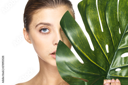 Fototapety, obrazy: portrait of young woman with green leaf