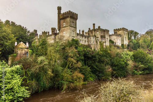 Photo Lismore Castle as seen from the Blackwater River below