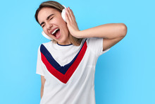 Young Woman Listening To Music Singing Along