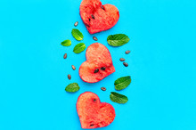 Creative Summer Food Concept. Juicy Slices Of Ripe Red Watermelon In The Shape Of A Heart And Mint Leaves On Blue Background. Flat Lay, Top View, Copy Space. Watermelon Pattern. Love For Watermelon