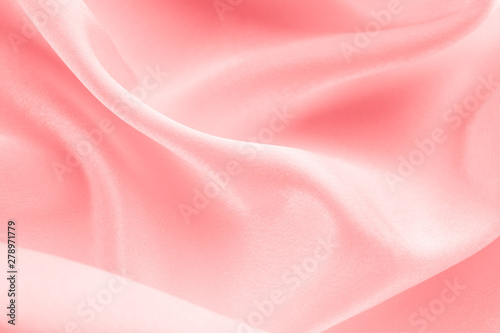 Fototapeta folds of coral fabric background, space for text