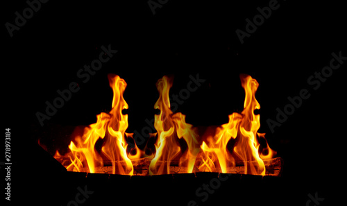 Fotobehang Vuur large orange flame on a black background