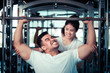 Couple exercising in the gym