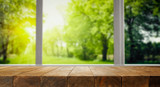 Table background and wooden board with blurred garden view