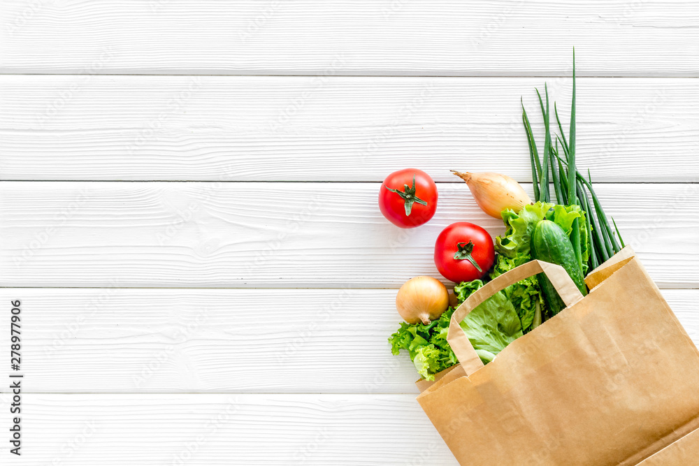 Fototapety, obrazy: Buying fresh vegetables in paper bag on white wooden background top view copyspace