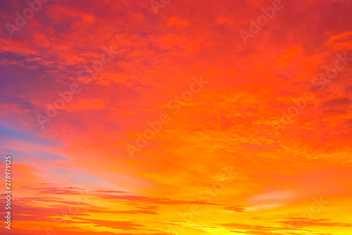 Foto auf Leinwand Rotglühen Amazing sunset.Colorful sky in the sunset. Natural Sunset Sunrise Over Field Or Meadow. Bright Dramatic Sky And Dark Ground.Sky background.