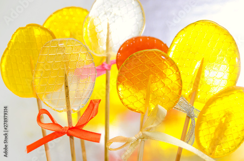 Fotografie, Obraz  Isomalt lollipops cockerels on sticks candies